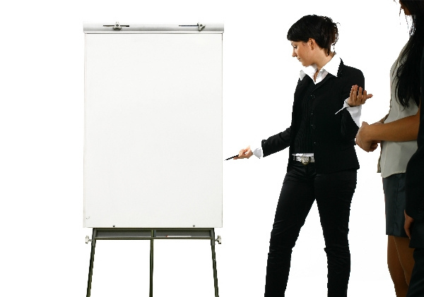 The business girl shows something on a board